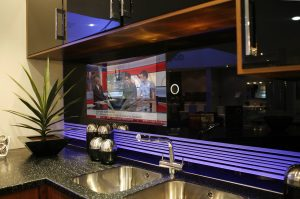 27 inch kitchen splashback TV smoked black glass.